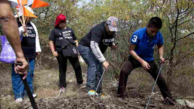 Relatives of 43 students who went missing in Iguala, Mexico, search for them on a hill on the outskirts of town on Nov. 29. After the students vanished, searches around Iguala have turned up nearly a dozen clandestine graves. None of the remains found in those mounds belonged to the students.