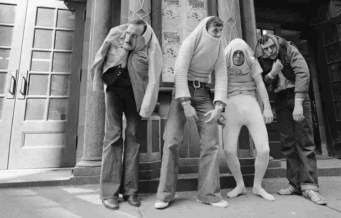 """John Cleese, pictured above in 1976 with Monty Python's Flying Circus (from left, Cleese, Michael Palin, Terry Gilliam and Terry Jones), says he worked hard to learn physical comedy by imitation — """"It was not something I was naturally gifted at,"""" he says."""