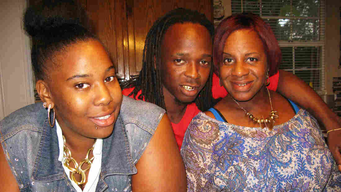 Stephanie George (right) with her daughter, Kendra, and son Courtney. They were 5 and 8 when she went to prison on a drug charge. Last December, President Obama commuted her sentence.