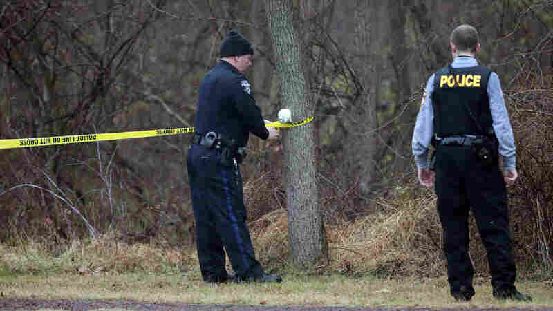 Police cordon off a wooded area during the search for suspect Bradley William Stone in Pennsburg, Pa., Tuesday.