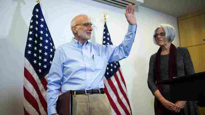American contractor Alan Gross, with his wife Judy, waves after delivering a statement to the news media in Washington, D.C., on Wednesday. Gross was freed after five years in a Cuban prison.