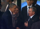 In this image from TV, President Obama shakes hands with Cuban President Raul Castro at the memorial service for former South African leader Nelson Mandela in Soweto in December 2013. It was reported to be just the second handshake between leaders of the two countries in 50 years.