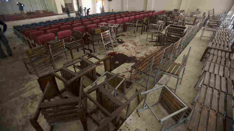 Chairs are upturned and blood stains the floor at the Army Public School auditorium the day after Taliban gunmen stormed the school in Peshawar, Pakistan.