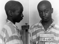 George Stinney, Jr., appears in an undated police booking photo provided by the South Carolina Department of Archives and History. A South Carolina judge vacated the conviction of the 14-year-old, who was executed in 1944, saying he didn't receive a fair trial.