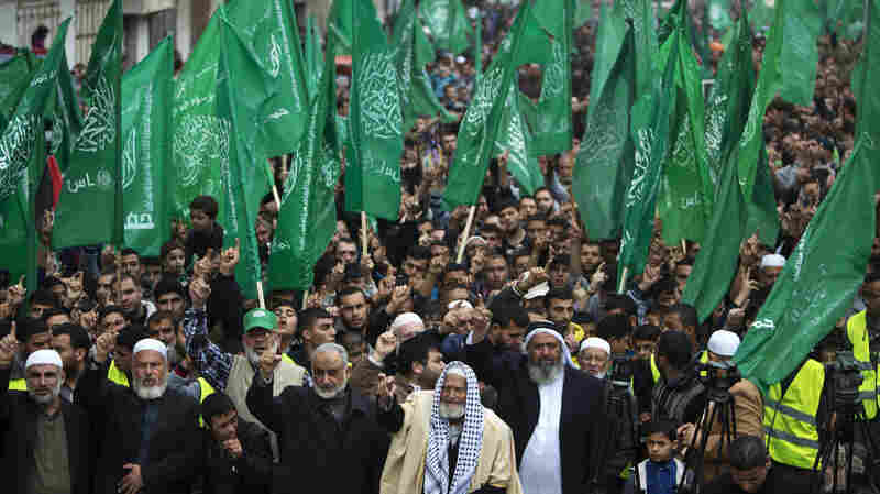 The Islamist group Hamas, shown here in a rally in the Gaza Strip on Dec. 12, is the strongest faction in the Gaza Strip. The Islamic State, or ISIS, is not believed to be in the territory, though flyers purporting to be from the group have circulated in Gaza. They are widely believed to be fake, but both Israel and Hamas have tried to use them to their advantage.