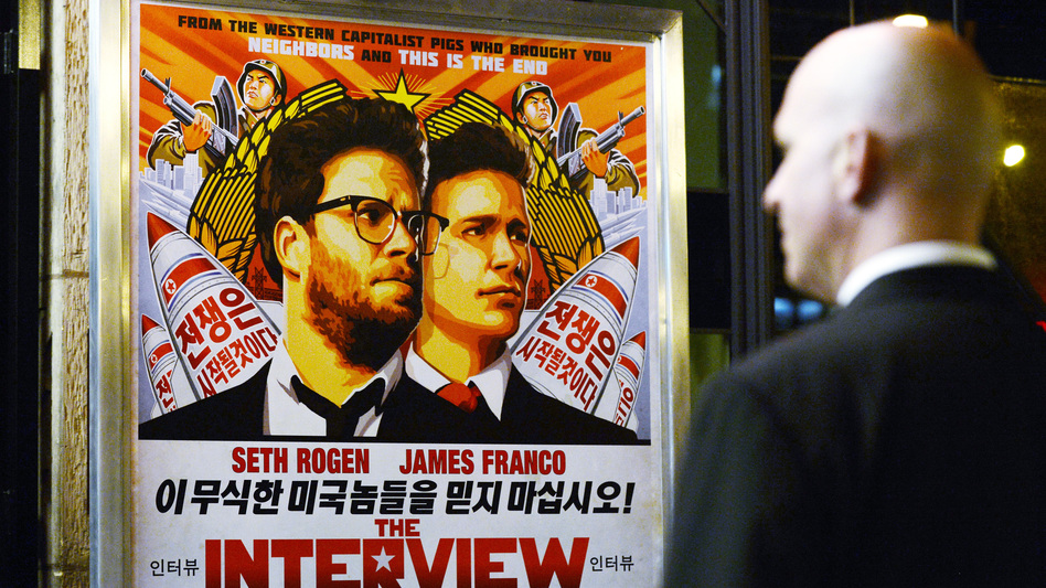 U.S. intelligence officials believe North Korea was centrally involved in the recent attack on Sony Pictures' computer network — possibly out of retribution for its film <em>The Interview</em>. Above, a security guard stands outside a theater during the film's premiere in Los Angeles last week. (Kevork Djansezian/Reuters/Landov)