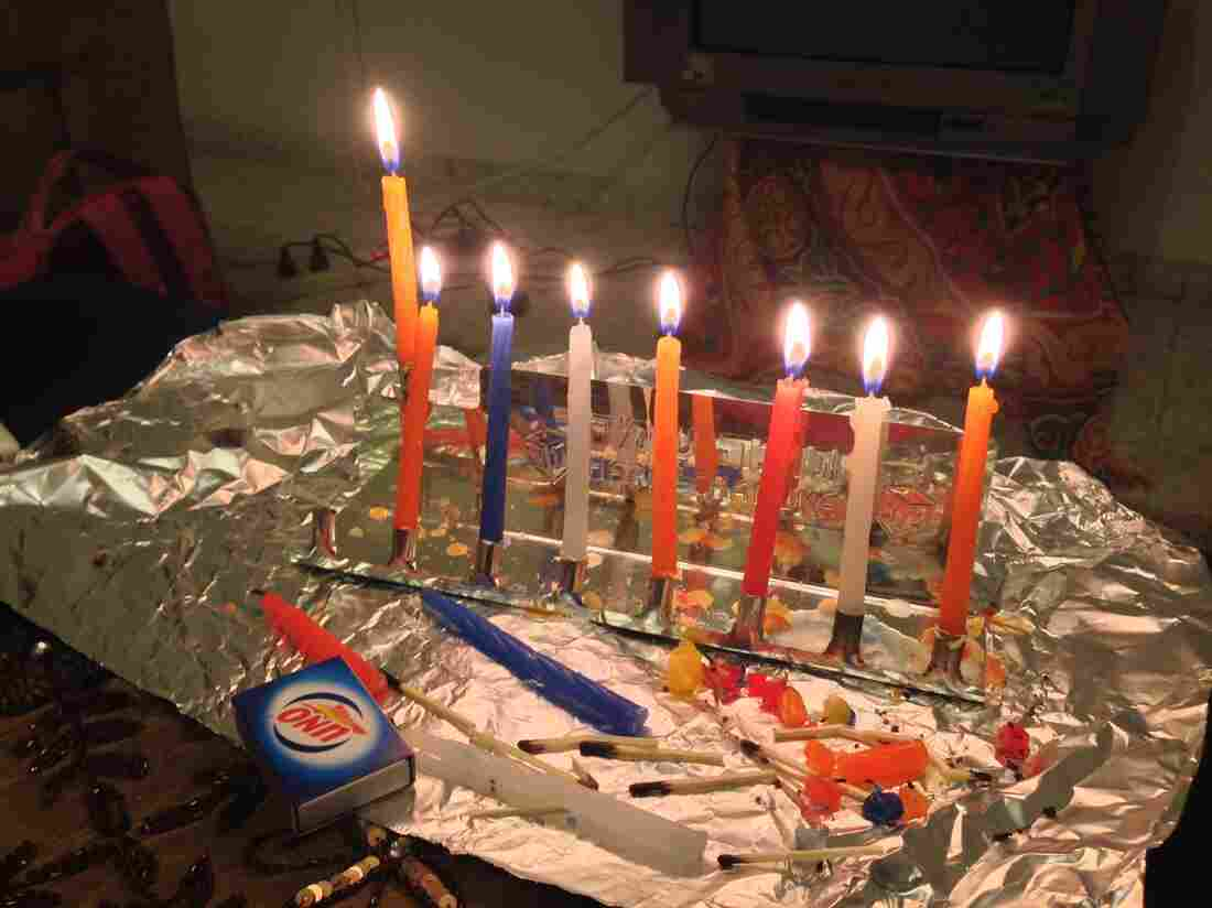 Wolf celebrated Hanukkah in the Palestinian city of Ramallah in the West Bank last year. As the holiday approached, she felt lonely, until her Palestinian host mother and a few neighbors came to watch her light candles on her portable tin menorah and hear her explain the holiday story.