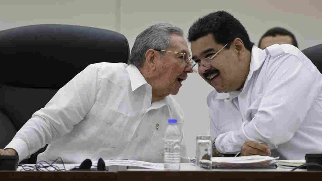 Cuban President Raul Castro (left) talks to his Venezuelan counterpart Nicolas Maduro at a summit in Havana on Oct. 20. The two countries are close allies that have been highly critical of the U.S. But with the U.S. and Cuba now planning closer ties, Cuba may tone down its anti-American rhetoric.