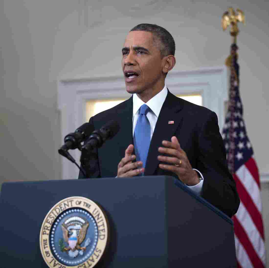 President Obama announces changes to U.S. policy on Cuba, including relaxing restrictions on U.S. banking in the country, in Washington, D.C. on Wednesday.
