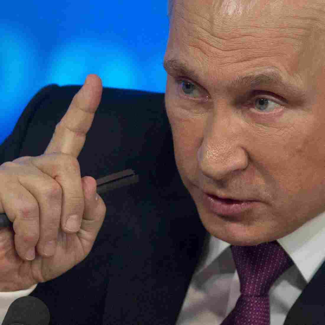 Russian President Vladimir Putin at his annual news conference in Moscow on Thursday, where he blamed Western sanctions and falling oil prices for his country's economic troubles.
