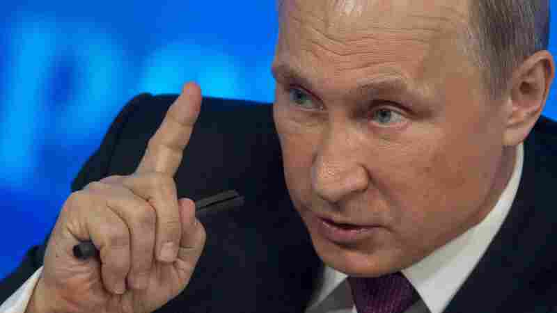 Russian President Vladimir Putin gestures during his annual news conference in Moscow, Russia, on Thursday, where he blamed Western sanctions and falling oil prices on his country's economic troubles.