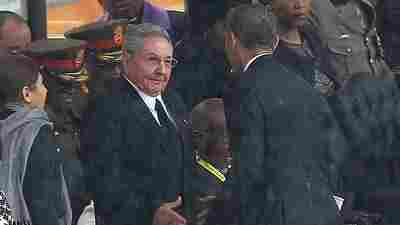 """President Obama shakes hands with Raul Castro during a memorial service for former South African President Nelson Mandela in Soweto, South Africa, on Dec. 10, 2013. Former Cuban leader Fidel Castro says his brother introduced himself to Obama in English, telling him, """"Mr. President, I'm Castro,"""" as the two leaders shook hands."""