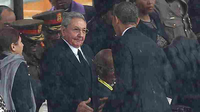 """Obama shakes hands with Castro during a memorial service for former South African President Nelson Mandela in Soweto, South Africa, on Dec. 10, 2013. Former Cuban leader Fidel Castro says his brother introduced himself to Obama in English, telling him, """"Mr. President, I'm Castro,"""" as the two leaders shook hands."""