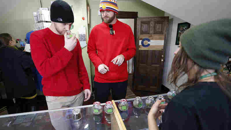 Nebraska and Oklahoma say Colorado's marijuana law is unconstitutional, in a challenge to the law in the Supreme Court. Earlier this month, visitors from Texas smell marijuana at the Breckenridge Cannabis Club.