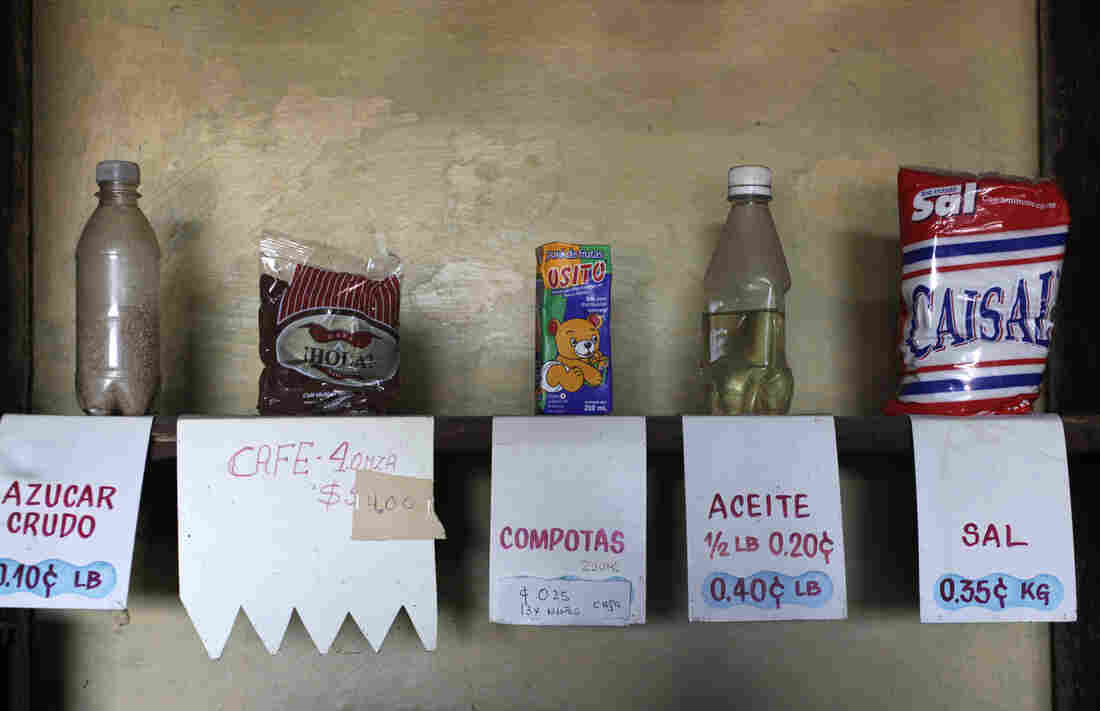 Sugar, coffee, fruit juice for babies, oil and salt inside a market subsidized by the government in Havana on July 11, 2013.