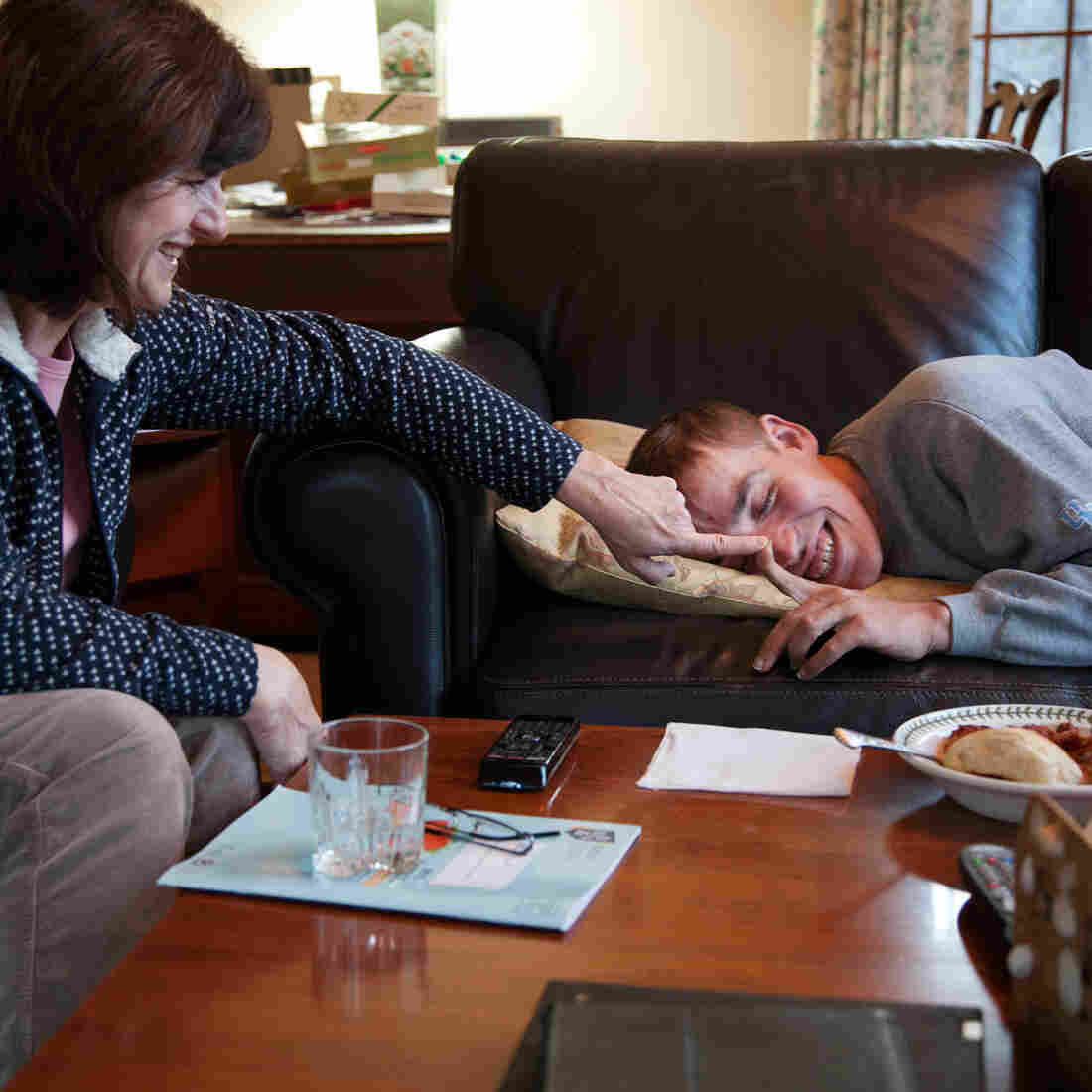 Katie Clapp shares a laugh with her son Andy Tranfaglia, 25, at their home in West Newbury, Mass. Andy has a rare genetic condition called fragile X syndrome.