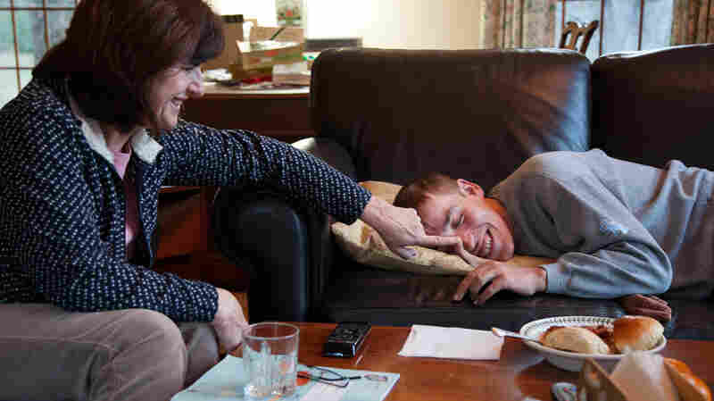 Katie Clapp shares a laugh with her son Andy Tranfaglia, 25, at their home in West Newbury, Mass. Andy has a rare genetic condition called Fragile X.