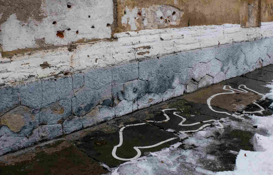 The wall where Nicolae and Elena Ceausescu were executed on Dec. 25, 1989. The white lines, added in 2013, show where they fell.