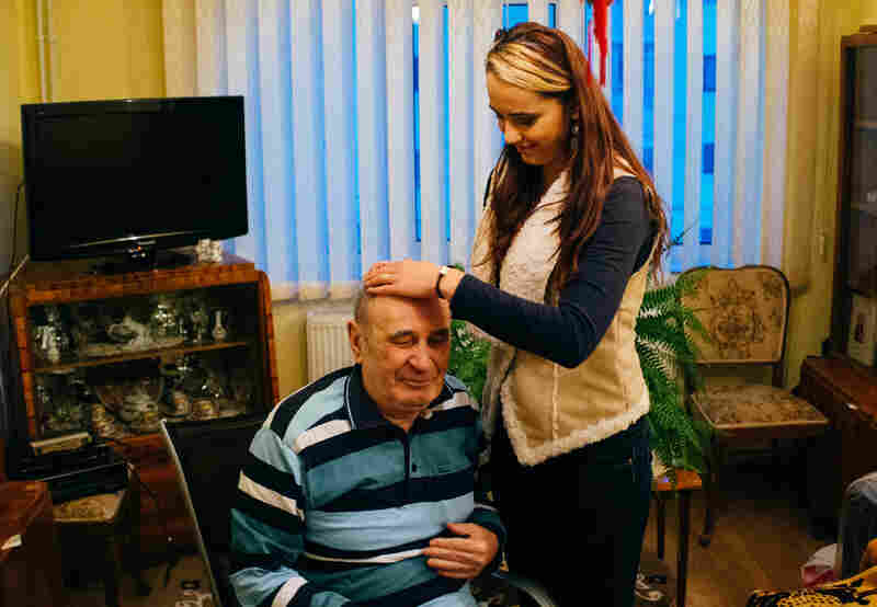 Retired Gen. Andrei Kemenici with his granddaughter Eliza Burcea. Keminici was the head of the Targoviste Garrison, where the Ceausescus were kept while awaiting trial from Dec. 22-25, 1989.