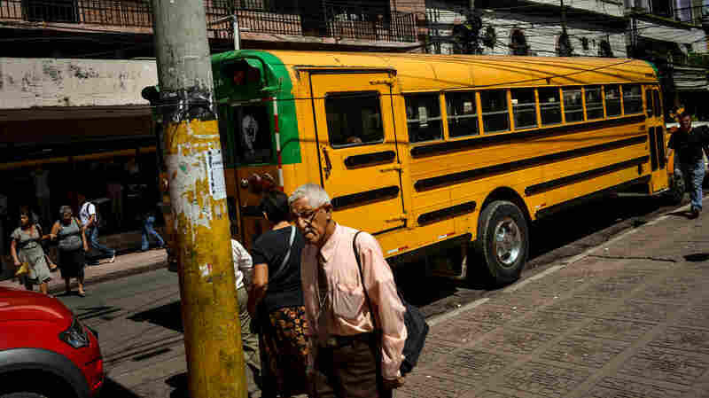 A bus travels through downtown Tegucigalpa, Honduras.