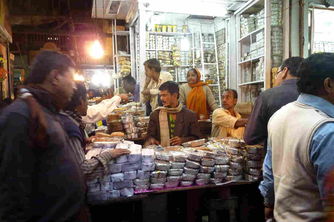 At Calcutta's famous New Market, vendors do brisk business in fruitcake as Christmas approaches.