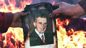 Romanians burn a portrait of Nicolae Ceausescu in Denta on Dec. 22, 1989, as residents take to the streets to celebrate the downfall of the dictator.