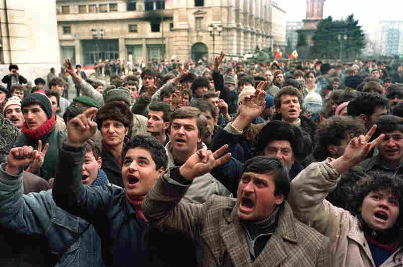 A crowd of Romanians gather in front of the Central Committee headquarters in Bucharest on Dec. 26, 1989, demanding a new government after the execution of former leader Nicolae Ceausescu and his wife, Elena.