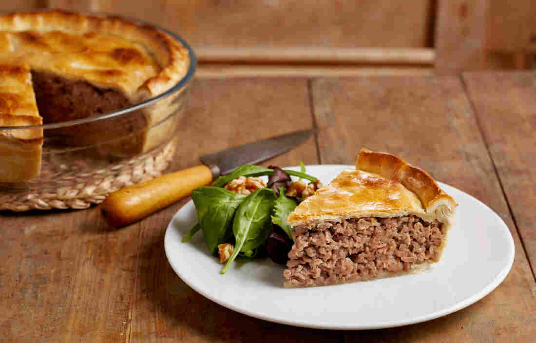 Tourtiere is a savory, spiced meat pie, which both French- and English ...