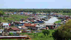 During the dry season, human waste makes the water putrid along the floating village of Prek Toal on Tonle Sap Lake.