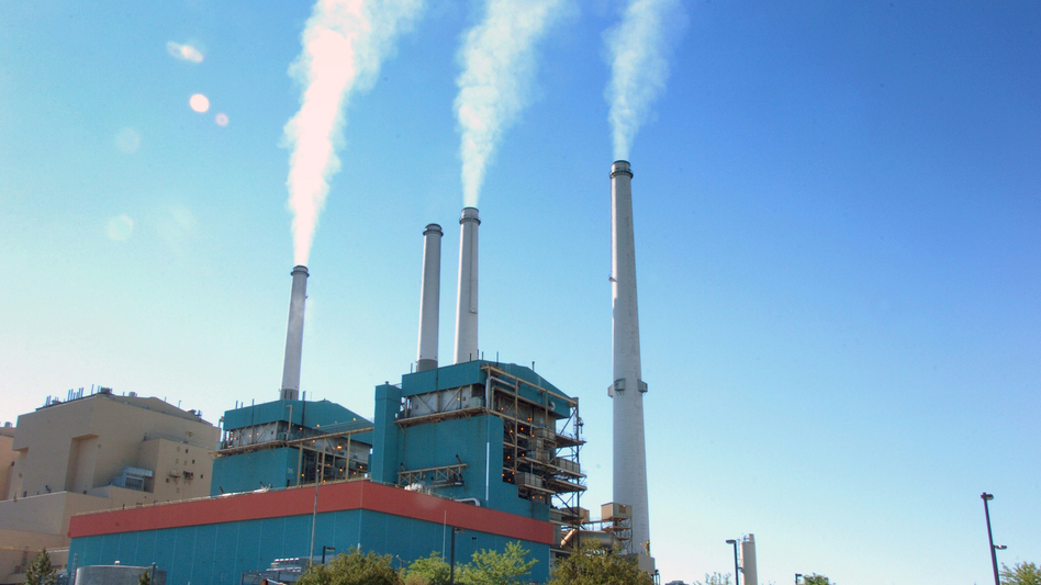 Smoke rises from the Colstrip Steam Electric Station, a coal burning power plant in in Colstrip, Mont., in September. New EPA guidelines treat toxic coal ash from such plants much the same as common household garbage.