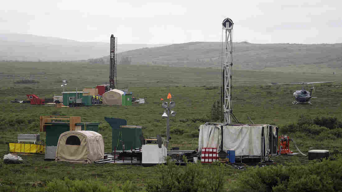 Workers with the Pebble Mine project test-drill in July 2007 in the Bristol Bay region of Alaska near the village of Iliamma.