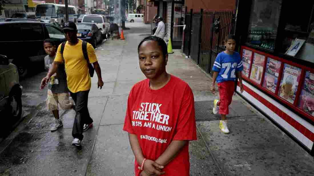 Shantel Walker stands outside a fast food restaurant June 19 in Brooklyn, New York. Walker, who made $8.25 per hour at a Brooklyn pizzeria, was part of a broad campaign by fast food workers to advocate for higher minimum wages.