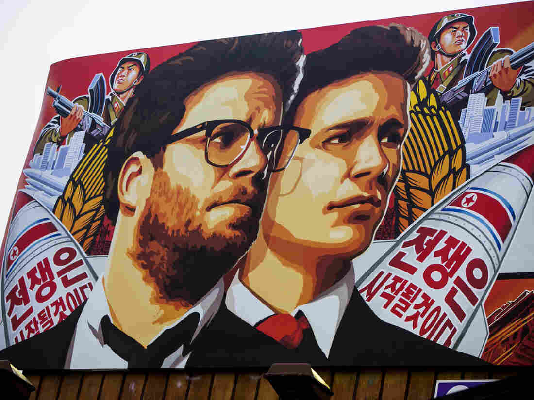 A banner for The Interview is posted outside Arclight Cinemas, in the Hollywood section of Los Angeles on Wednesday. The theatrical release of the film has been cancelled following cyber attacks and threats believed to originate in North Korea.