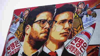 A banner for The Interview is posted outside Arclight Cinemas in the Hollywood section of Los Angeles on Wednesday. The theatrical release of the film has been cancelled following cyber attacks and threats believed to originate in North Korea.