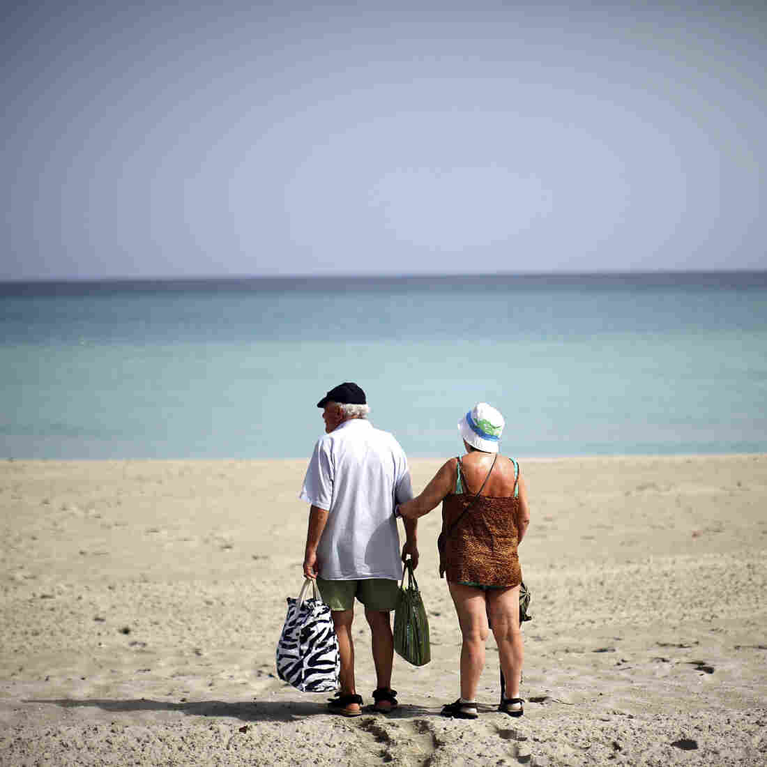 A couple walks on the beach in the resort area of Varadero, Cuba. Varadero is home to upscale hotels and resorts that cater to foreign tourists, but there aren't yet enough to handle a potential influx of Americans.