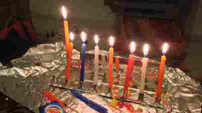 Wolf celebrated Hannukah in the Palestinian city of Ramallah in the West Bank last year. As the holiday approached, she felt lonely, until her Palestinian host mother and a few neighbors came to watch her light candles on her portable tin menorah and hear her explain the holiday story.