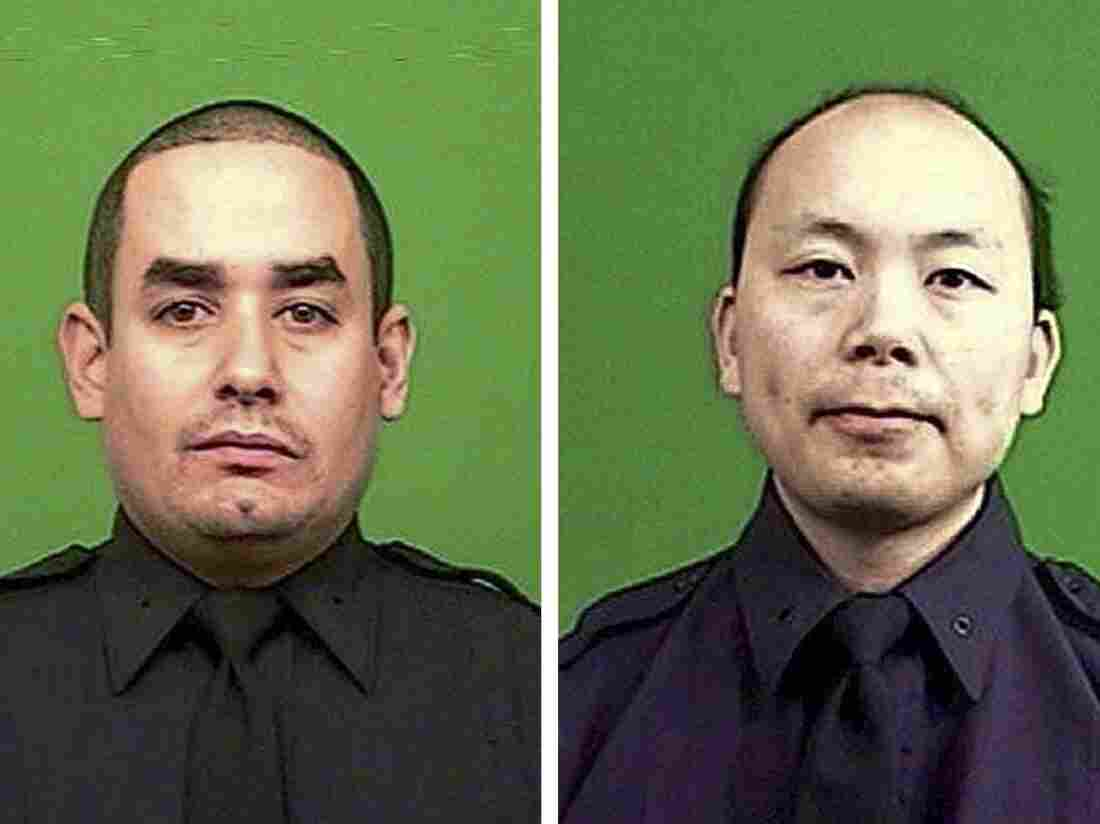 Officer Rafael Ramos (left) and Wenjian Liu (right) were killed on Saturday in an ambush by a gunman in a Brooklyn neighborhood.