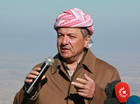 Iraqi Kurdish regional President Massoud Barzani speaks with the media at Mount Sinjar, in the town of Sinjar, on Sunday. Barzani was visiting an area that was recently retaken from ISIS militants.