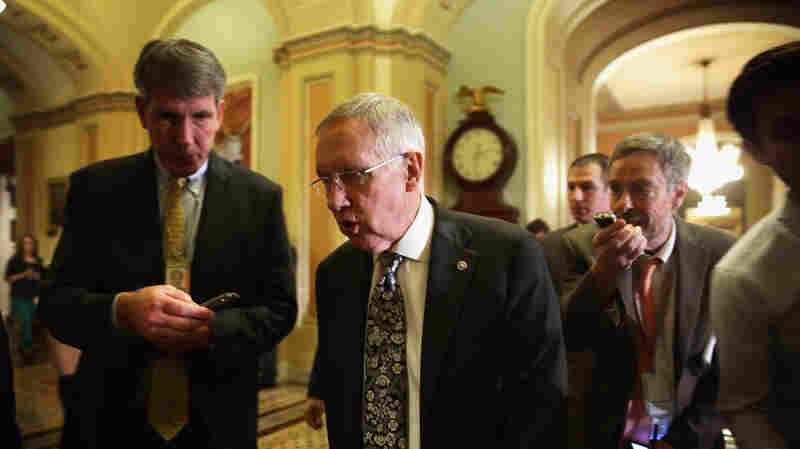 U.S. Senate Majority Leader Sen. Harry Reid, shown walking towards the Senate chamber on December 16, pushed through a final batch of judicial nominees this month, before the Republican-dominated Senate takes over in the new year.