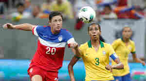 United States' Abby Wambach fights for the ball with Brazil's Bruna Benites during a final match of the International Women's Football Tournament in Brasilia, Brazil, Sunday. The game ended in a draw, giving Brazil the tournament victory.