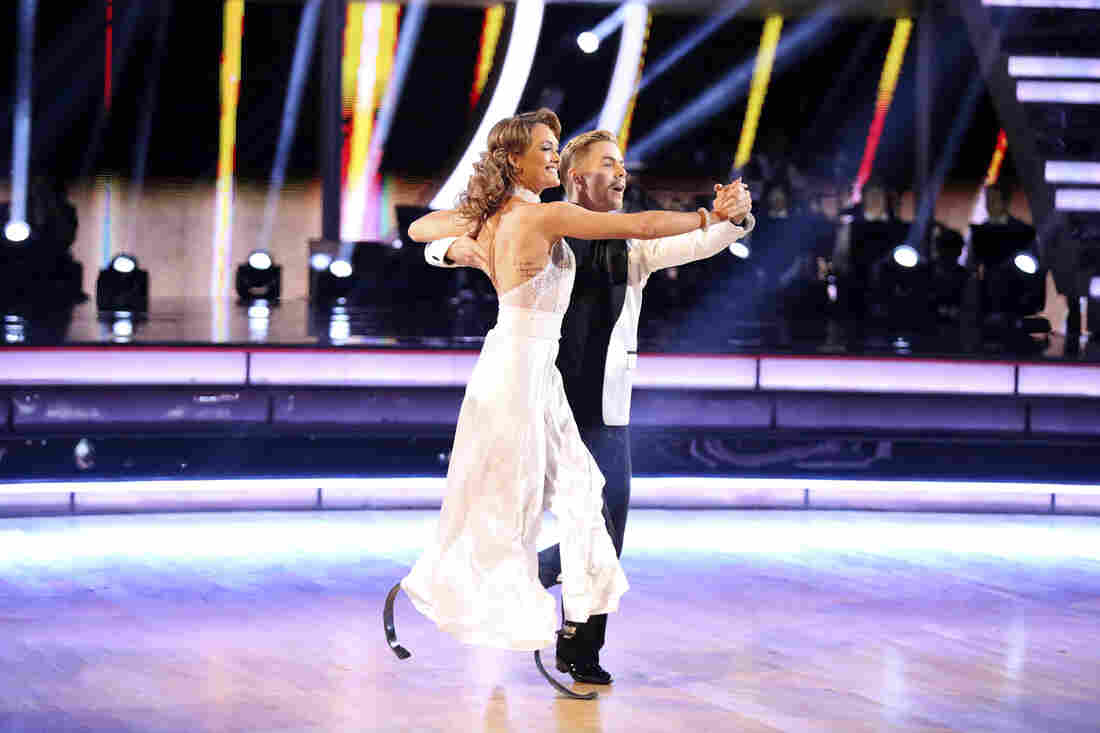 Amy Purdy, who lost both lower legs because of bacterial meningitis, performs with Derek Hough on Dancing With The Stars.