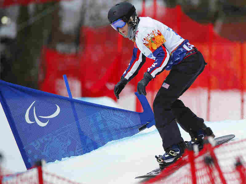 Purdy competes in the women's snowboard cross in the 2014 Winter Paralympics in Russia.