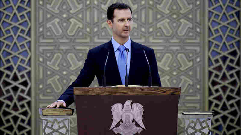 Syrian President Bashar Assad, shown here in July, appeared to be in a tough position at the beginning of the year. But many analysts say his hold on power grew stronger over the course of 2014, due in part to the U.S. bombing campaign against the Islamic State.