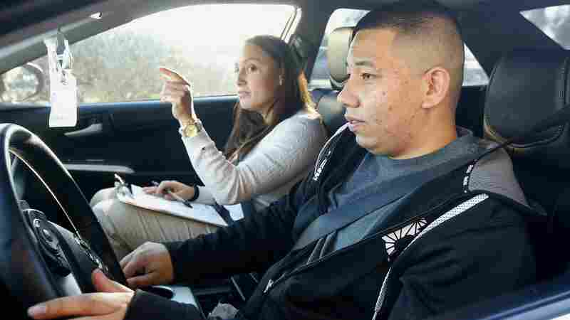Ramon Maldonado takes his driving test with the Arizona Department of Transportation Motor Vehicle Division. Many young immigrants protected from deportation under the Obama administration's new policies began pursuing driver's licenses in the state Monday.
