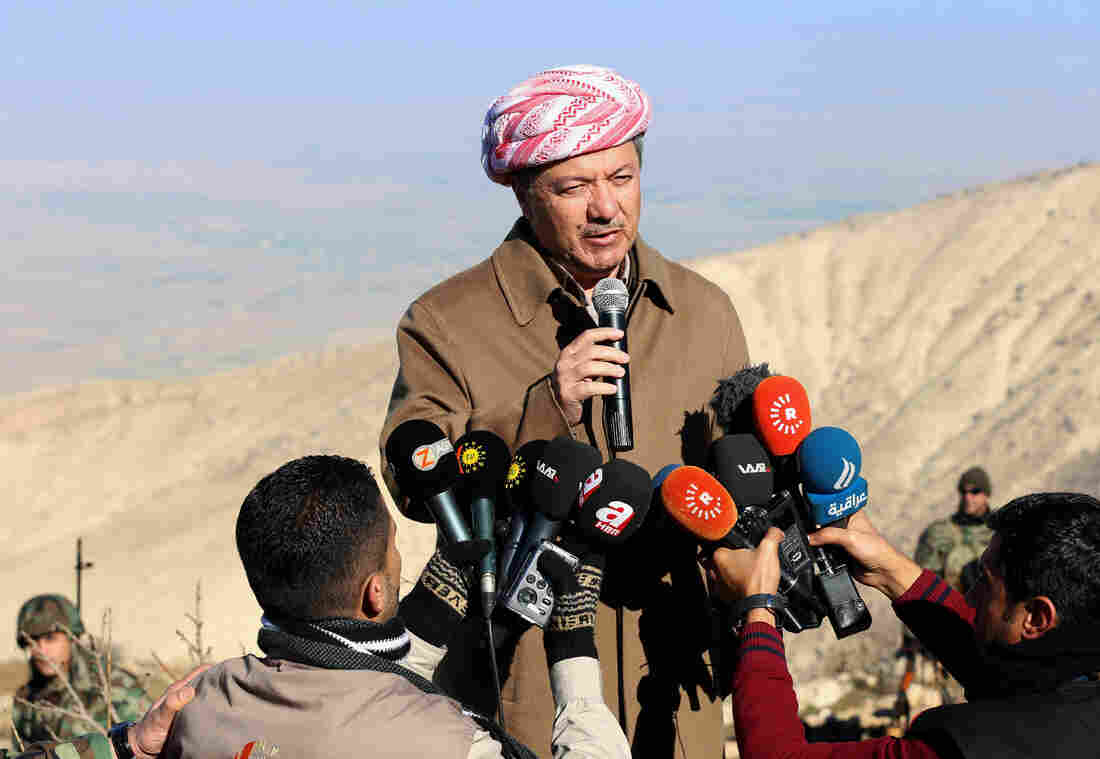 Iraqi Kurdish leader Masoud Barzani praises the advances of Kurdish peshmerga fighters against the Islamic State on Dec. 21, during a visit to Mount Sinjar. Earlier in the year, he had pledged a referendum on Kurdish independence. But for now, that's been put on hold.