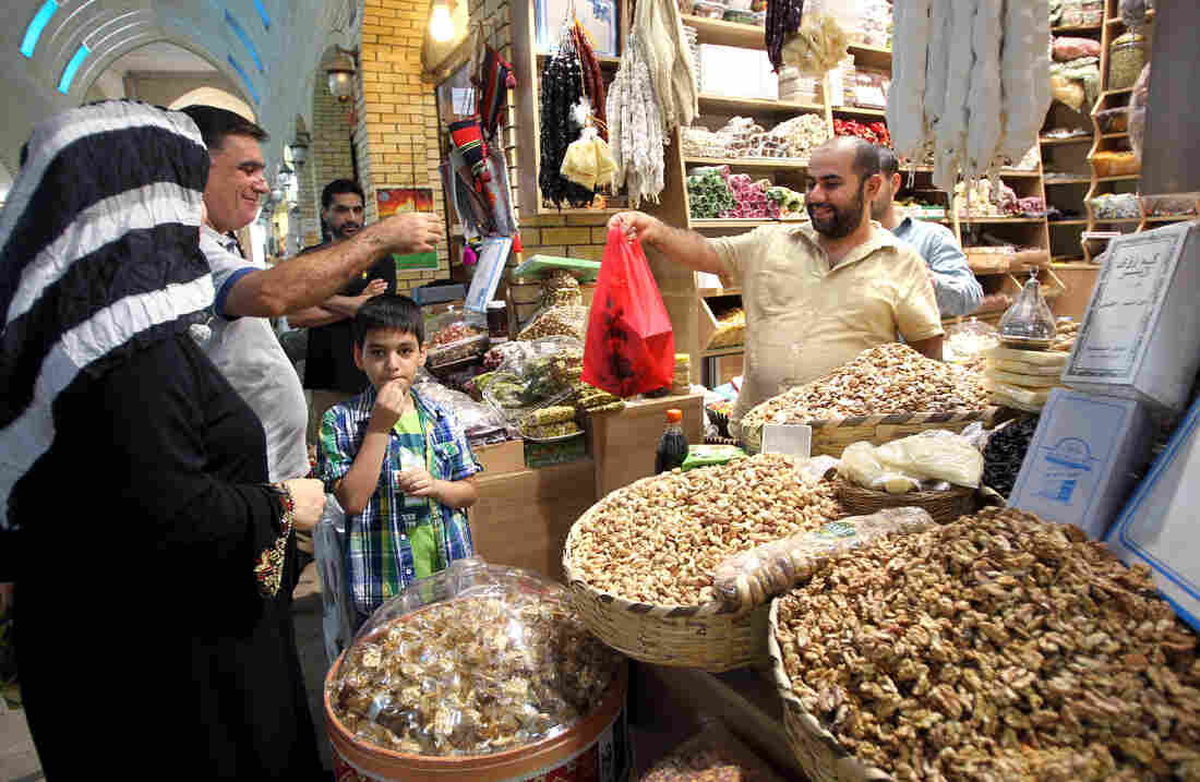 Iraqis shop for food items at a market near the citadel in Irbil, the capital of the autonomous Kurdish region of northern Iraq, in August.