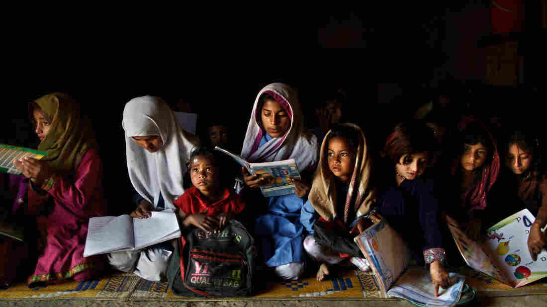 These Pakistani children go to a makeshift school in a clay house, located in a poor neighborhood on the outskirts of Islamabad.