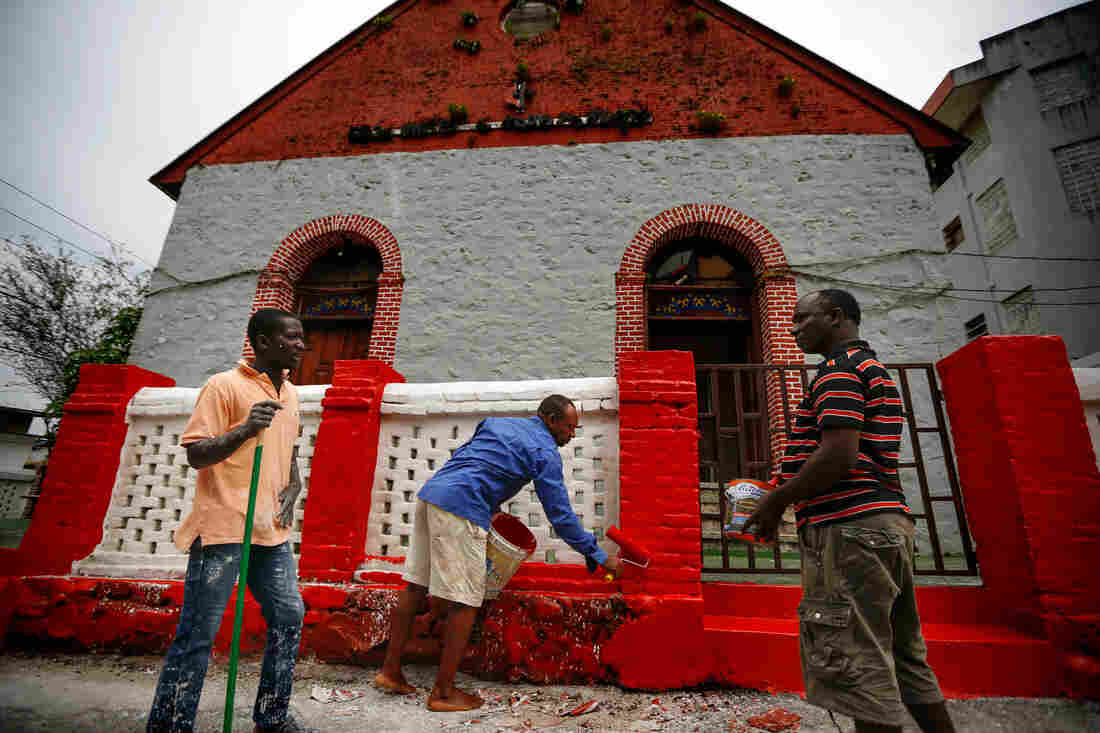 The Liberian government demands a fresh coat of paint on every building before Christmas. Painters spruce up the United Methodist Church in Monrovia.