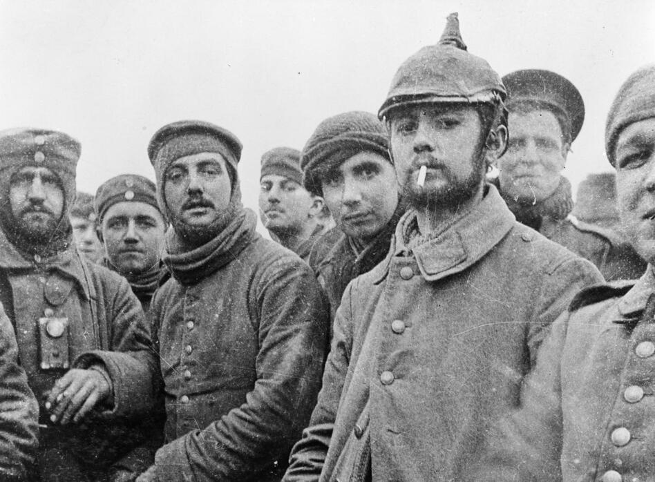 British and German soldiers fraternizing at Ploegsteert, Belgium, on Christmas Day 1914. World War I was raging at the time, but front-line troops initiated the truce, which they documented in photos and letters. Commanders on both sides were furious when they learned of it. (Courtesy of Imperial War Museum)