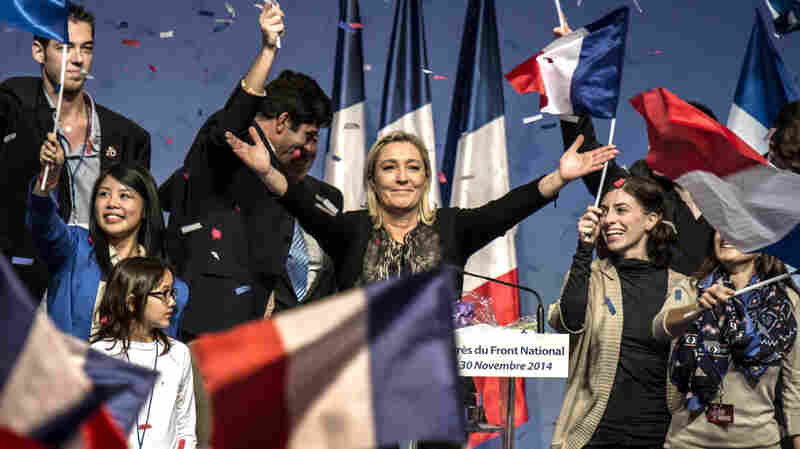 Marine Le Pen, (center) leader of France's far-right National Front party, waves to the audience in November in Lyon. She has visited Russia on several occasions and a Russian bank recently lent her party $11 million.